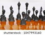 chessmen on the board   Shutterstock . vector #1047993160