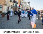 "Small photo of PROCIDA, ITALY - MARCH 25, 2016 - Every year the procession of the ""Misteri"" is celebrated at Easter's Good Friday in Procida, Italy. Islanders carry through the streets elaborate and heavy ""Misteries"