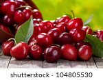 Small photo of fresh cherries on wooden table
