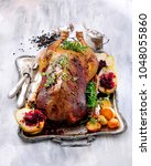 roast goose with pears  red... | Shutterstock . vector #1048055860