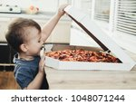 the child is astonished by a... | Shutterstock . vector #1048071244