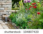 Garden Flowers With Stone...