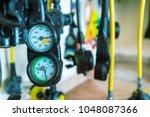 diving equipment neatly folded...   Shutterstock . vector #1048087366