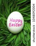 single happy easter egg hidden... | Shutterstock . vector #1048092004