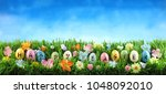 bright colorful easter eggs... | Shutterstock . vector #1048092010