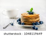 pancakes with blueberries and... | Shutterstock . vector #1048119649