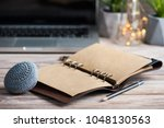 workspace with empty diary ... | Shutterstock . vector #1048130563