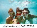 Cheerful Women Friends Swimmin...
