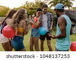 group of men and women playing... | Shutterstock . vector #1048137253