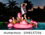 man standing on inflatable... | Shutterstock . vector #1048137256