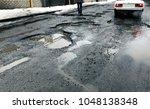 broken city asphalt road with a ... | Shutterstock . vector #1048138348
