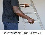 an electrician holds an... | Shutterstock . vector #1048159474