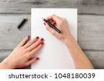 view from above to woman's... | Shutterstock . vector #1048180039