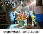chef at work in the restaurant... | Shutterstock . vector #1048189909