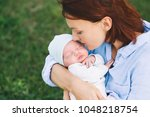 loving mother with her newborn... | Shutterstock . vector #1048218754