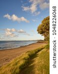 Small photo of 90 Mile Beach before sunset in Ahipara, Northland, New Zealand
