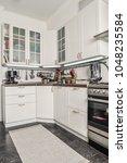 interior of the kitchen in... | Shutterstock . vector #1048235584