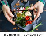 woman hands takes food photo of ... | Shutterstock . vector #1048246699