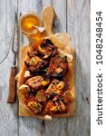 glazed pork spare ribs with... | Shutterstock . vector #1048248454