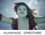 maddison powell underwater in... | Shutterstock . vector #1048251880
