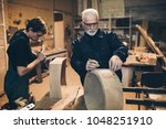 Two Master Carpenters Working...