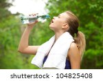 young beautiful woman drinking... | Shutterstock . vector #104825408