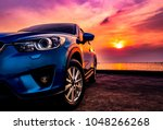 blue compact suv car with sport ... | Shutterstock . vector #1048266268