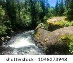 rushing river rapids near...   Shutterstock . vector #1048273948