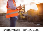 asian engineer with hardhat... | Shutterstock . vector #1048277683