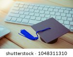 graducate cap on keyboard with... | Shutterstock . vector #1048311310