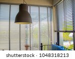 white louvers or pull up blind... | Shutterstock . vector #1048318213