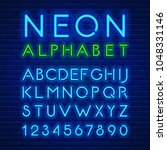 blue neon light glowing latin... | Shutterstock .eps vector #1048331146