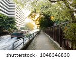 boat moving on canal at bangkok ... | Shutterstock . vector #1048346830