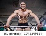 brutal strong bodybuilder... | Shutterstock . vector #1048349884