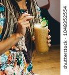 young girl drinking iced lemon... | Shutterstock . vector #1048352554