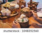 bao bun sandwich served with... | Shutterstock . vector #1048352560
