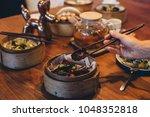 bao bun sandwich served with... | Shutterstock . vector #1048352818
