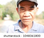 close up of asian old man  in... | Shutterstock . vector #1048361800