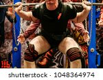 Small photo of powerlifter in knee wraps exercise squat powerlifting