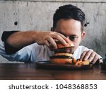 master chef putting bun on top... | Shutterstock . vector #1048368853