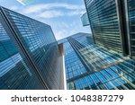 glass architecture of modern... | Shutterstock . vector #1048387279