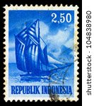 INDONESIA - CIRCA 1956: A stamp printed in Indonesia shows image of a ship, circa 1956 - stock photo