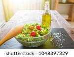 tasty salad in a bowl on wooden ...   Shutterstock . vector #1048397329
