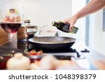 close up of male hand pouring... | Shutterstock . vector #1048398379