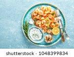 grilled shrimps or prawns... | Shutterstock . vector #1048399834