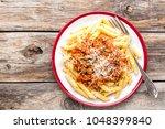 pasta bolognese. macaroni... | Shutterstock . vector #1048399840