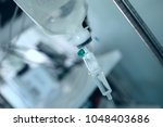 iv dropper on the steel pole in ... | Shutterstock . vector #1048403686