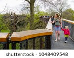 Small photo of London, UK - April 18, 2014. Treetop Walkway at Kew Botanic Gardens. The walkway allows visitors to walk through 200 metres of forest canopy