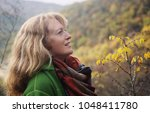 outdoor portrait of happy 40... | Shutterstock . vector #1048411780