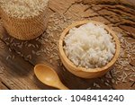 jasmine rice in wood bowl and... | Shutterstock . vector #1048414240